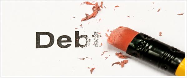 """An eraser working hard to erase the word """"debt"""""""