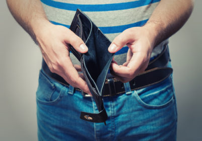 A man holding open his empty wallet