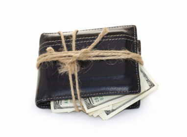 A wallet that is all tied up with twine.