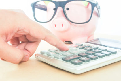a piggy bank and a calculator